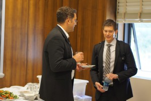 Dr. Vojislav Stamenkovic and Prof. Tom Jaramillo exchange ideas at an I²CNER event